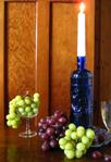 candle in wine bottle centerpiece