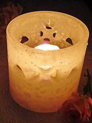 Hurricane candle centerpiece with ironed-in designs