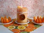 Chunk orange candle centerpiece with fresh oranges